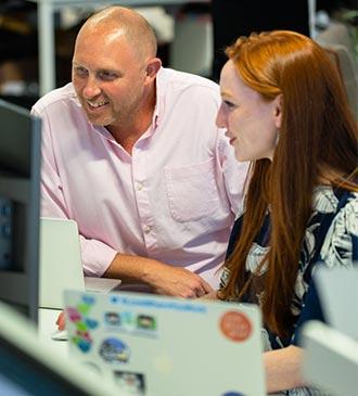 Engineering team looking at computer screens